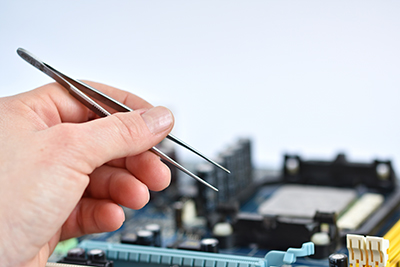 electronic printed circuit board being repaired