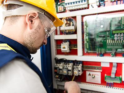 BMS Technician working on BMS system in Switchboard panel