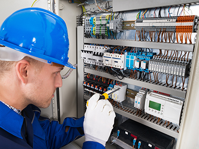 Building Automation Facts & Terms technician working in a control panel