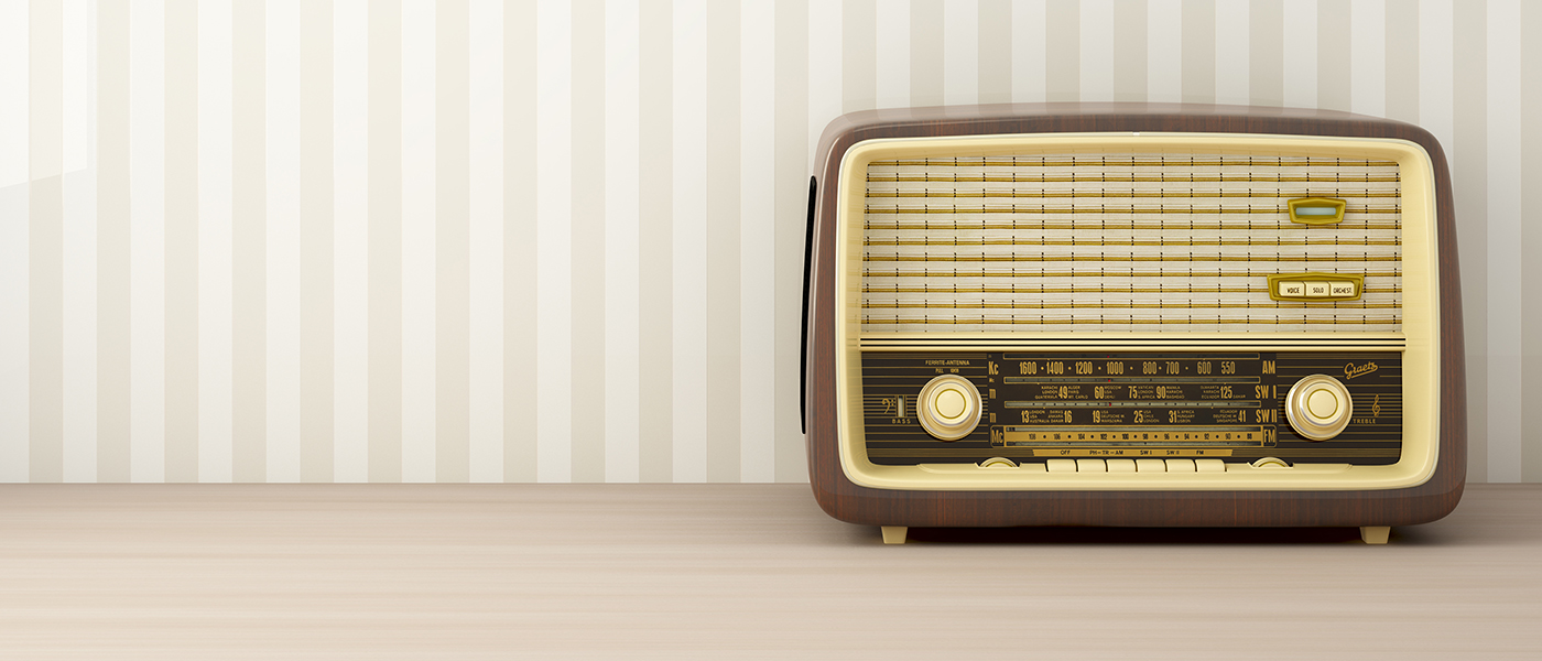old technology valve transistor radio will a 1960s wall paper background
