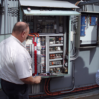 Club Managers can save money and time with our holistic technical services Repairs on a roof top switchboard for HVAC mechanical Services