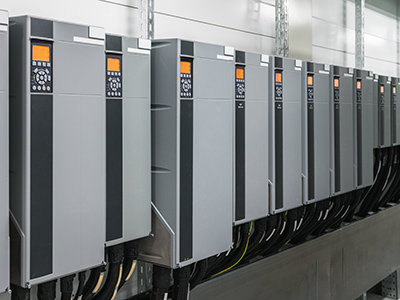 Varible Speed Drives which serve HVAC Pumps and Fans installed on Plant room wall adjacent Chilled water Varible Speed Drives Sydney
