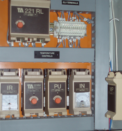 Obsolete building services controls in a mechanical services switchboard HVAC
