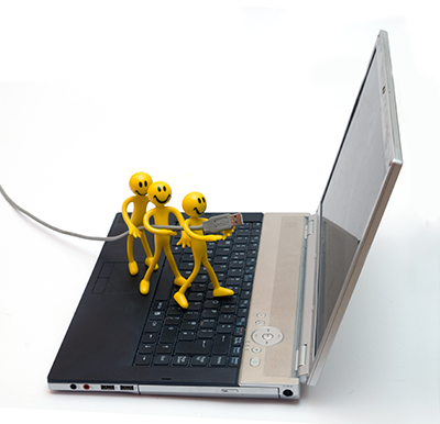 laptop with little men on it