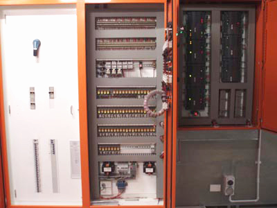 Building Management System Maintenance Mechanical Services switchboard with BMS controllers on the left hand side