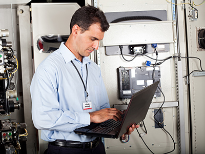 Energy Audit Strategy Technician performing programmed maintenance