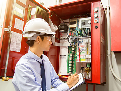 Fire Systems technician performing programmed maintenance